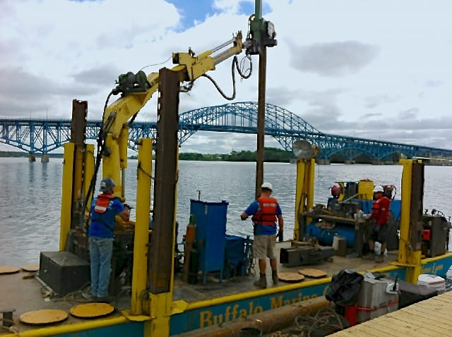 Image of workers on barge setting a piling