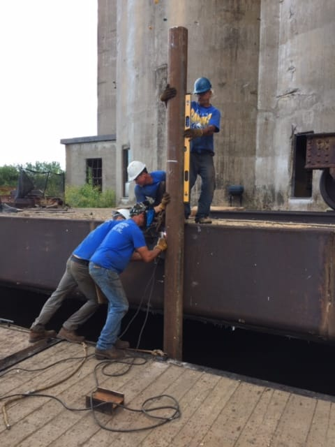 Image of workers setting piling
